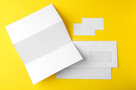 Blank brochure, envelope and card on yellow background Stock Photo