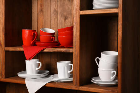 Wooden shelves with white and red rustic dinnerware