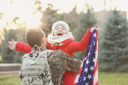 USA soldier hugging his daughter outdoors Stock Photo