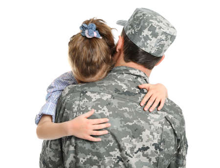 Soldier in camouflage hugging his daughter on white background