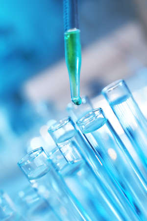 Pipette dropping a sample into a test tube, closeup Stock Photo