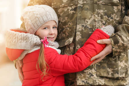 Little girl and her father in military uniform outdoors Stock Photo