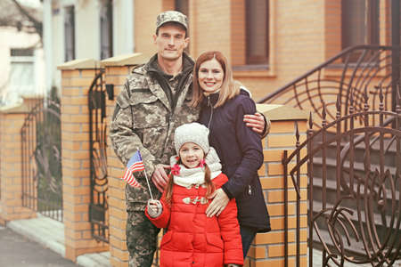 USA soldier with his family outdoors