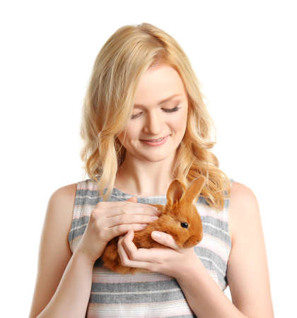 Beautiful girl holding small rabbit on white background Stock Photo