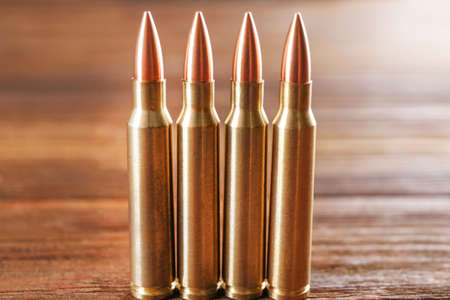 Bullets on wooden background Stock Photo