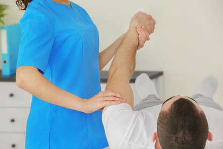 Physiotherapist working with patient in clinic