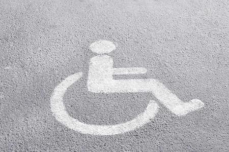 Symbol of handicapped on parking place Stok Fotoğraf