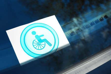 Symbol of handicapped on car windshield, closeup Reklamní fotografie