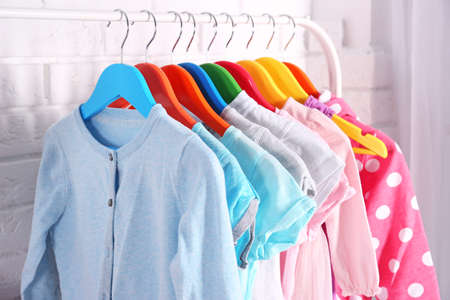 Children clothing on hanger stand in dressing room