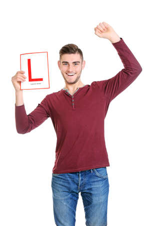 Young man with learner driver sign on white background