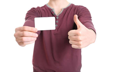 Young man with blank card on white background, closeup