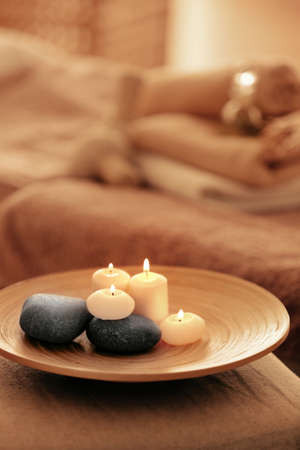 Spa set with candles and stones on tray