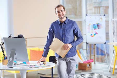 Modern designer working in office