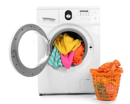 Clothes in washing machine on white background
