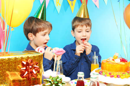 Cute little twins celebrating birthday at home