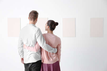 Young couple at art gallery