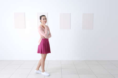 Young woman at art gallery Stock Photo