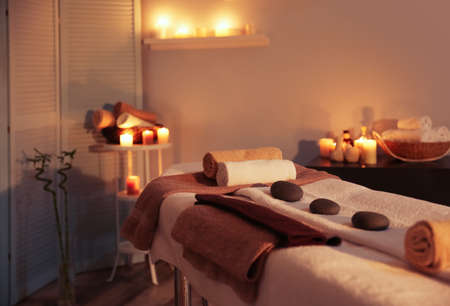 Interior of modern massage room in candle light