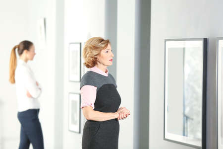 Beautiful women in modern art gallery
