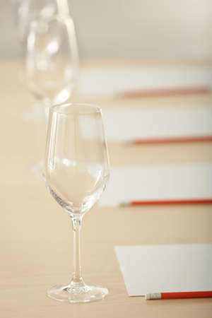 Glasses and cards prepared for wine estimating on table