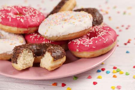 Tasty glazed donuts on color background Stock Photo