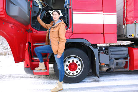 Female driver near big modern truck outdoors Stock Photo