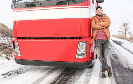 Handsome driver near big modern truck outdoors Stock Photo