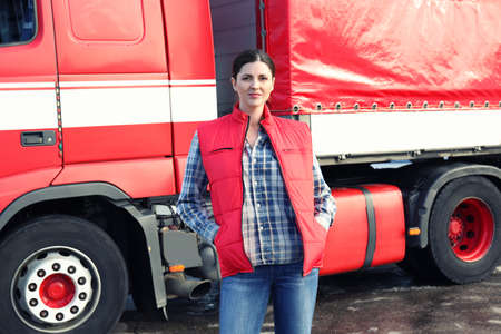 Young female driver near big modern truck outdoors Stock Photo