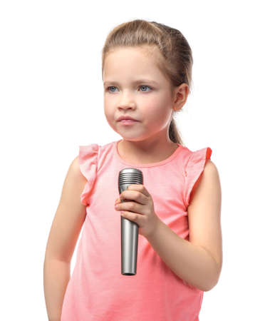 Cute little girl with microphone on white background Stock Photo