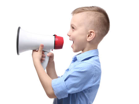 Cute little boy with megaphone on white background Фото со стока