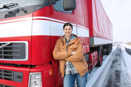 Female driver near big modern truck outdoors