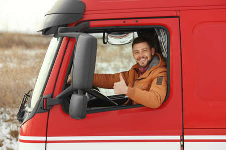 Young man driving big modern truck Stock Photo - 97728374