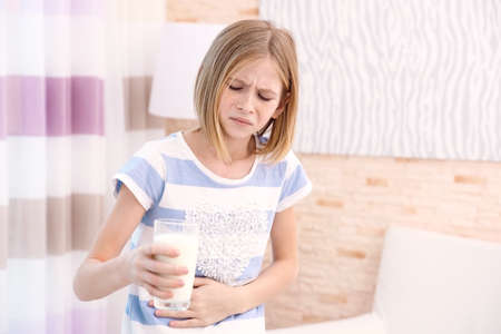 Girl with milk allergy at home