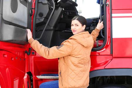 Female driver near big modern truck outdoors Standard-Bild