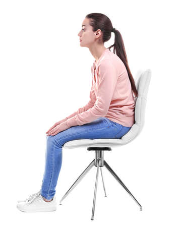 Posture concept. Young woman sitting on chair against white background