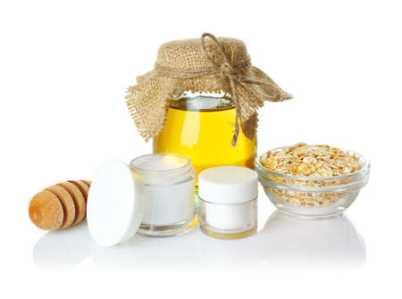 Honey and cosmetics on white background