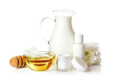 Honey, milk and cosmetics on white background