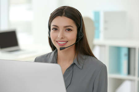 Pretty technical support dispatcher working in office
