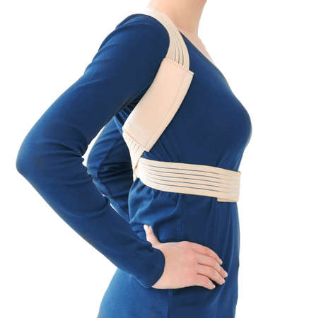 Posture concept. Woman wearing corset on white background