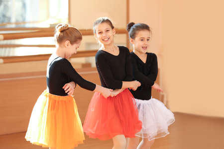 Cute little ballerinas in dance studio
