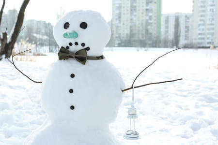 Christmas holiday concept. Sad snowman in wintertime