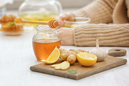Natural medicine for flu on kitchen table Stock Photo