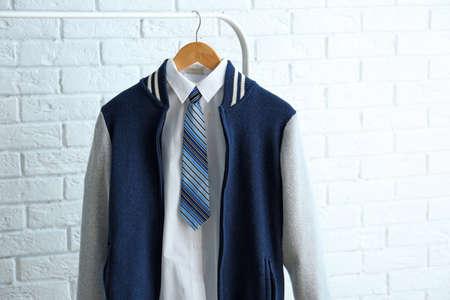 School uniform of teenage boy on hanger Reklamní fotografie