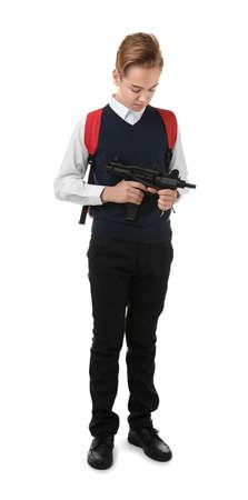 Schoolboy holding machine gun on white background Stock Photo