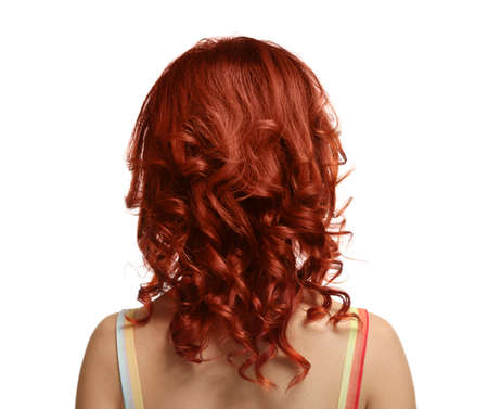 Beautiful young woman with dyed curly hair on white background 版權商用圖片