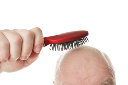 Bald senior man with hair brush on white background, closeup