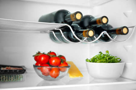 Wine bottles and products in refrigerator