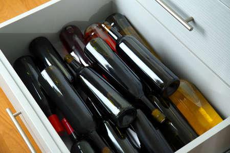 Kitchen drawer with assortment of wine bottles, closeup 版權商用圖片
