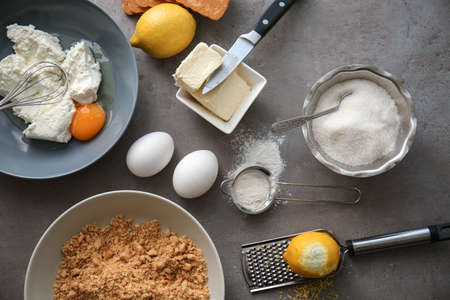 Ingredients for cheesecake on kitchen table Stock Photo