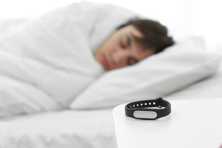 Sleep tracker and blurred resting man on background